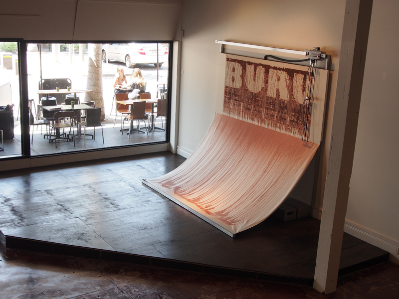 Robert Andrew,  Transitional text , (installation view) 2015, Electro-mechanical erasure machine, dimensions variable.