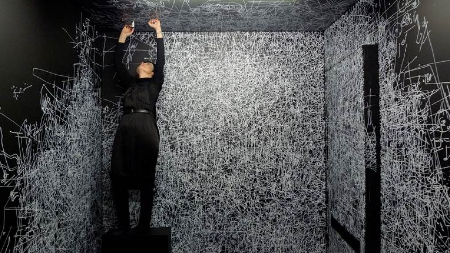Gosia Wlodarczak,  A Room Without A View — drawing performance Day 5 , 2013, a 17-day drawing performance held in a specially constructed sensory limitation room at the RMIT Gallery, Melbourne. Pigment pen, polymer paint on MDF board, space dimensions: 260 x 340 x 220 cm. Photographer Longin Sarnecki. Image courtesy the artist and Fehily Contemporary, Helen Maxwell and BOXOProjects New York/Joshua Tree