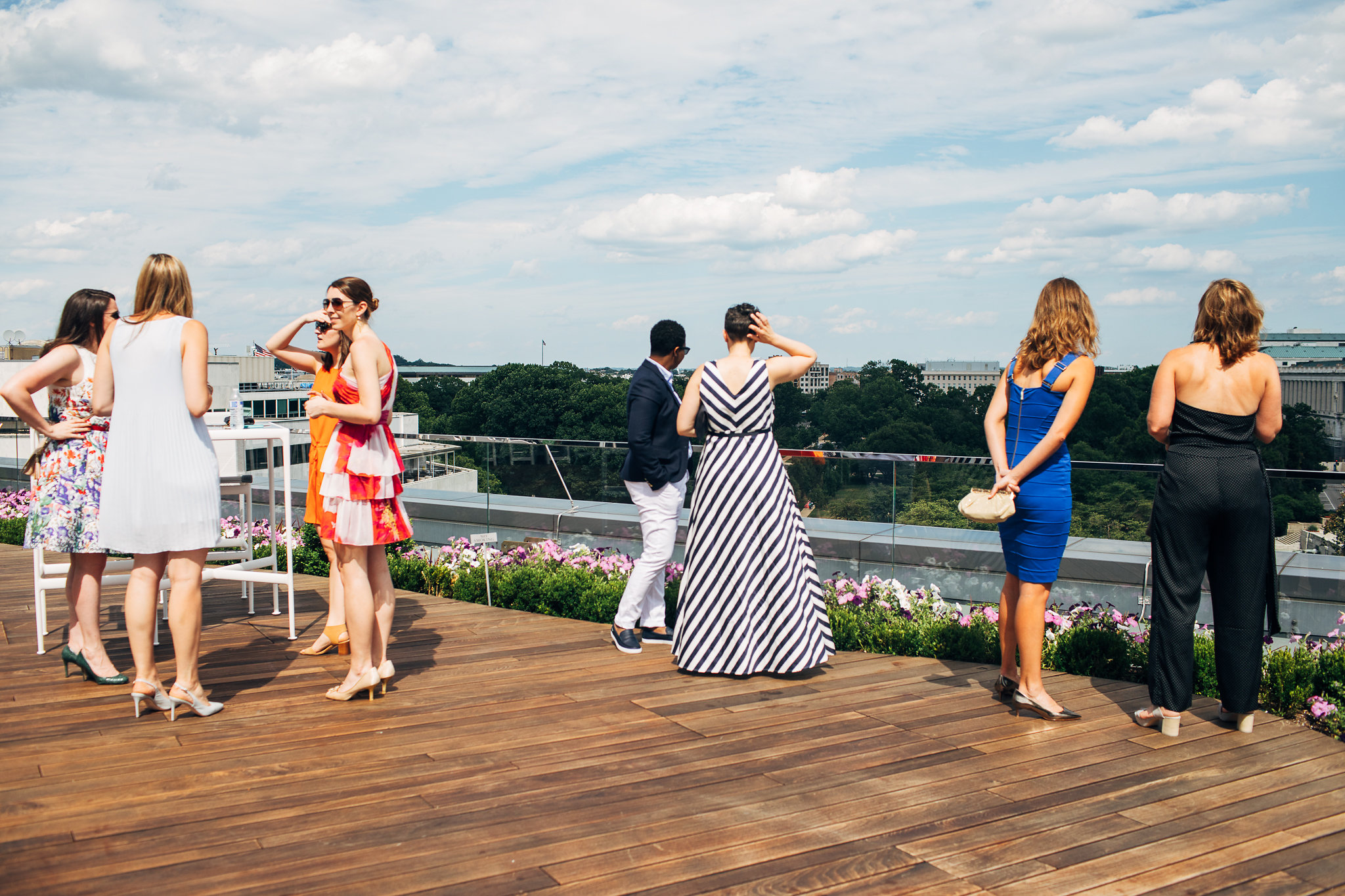 Event attendees socializing on the rooftop deck