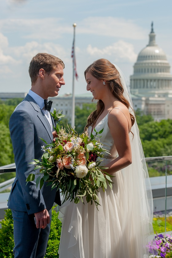 Engaged couple posing for wedding portrait, with Capitol building in background