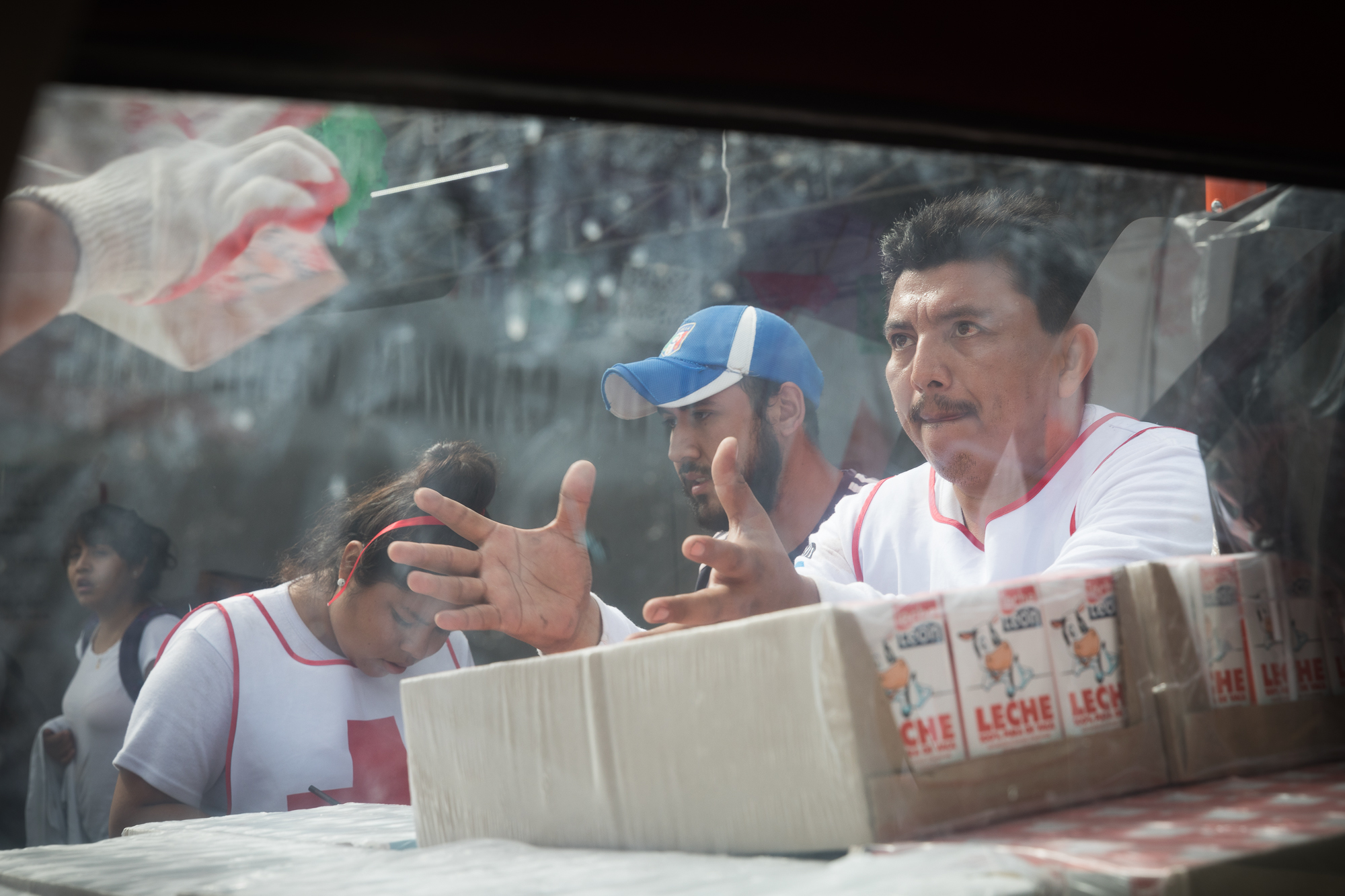 Mexican Red Cross and volunteers oading provisions to distribute to impacted communities at the Red Cross headquarters in Cuautla Morelos. PHOTO: Francisco Alcala Torreslanda