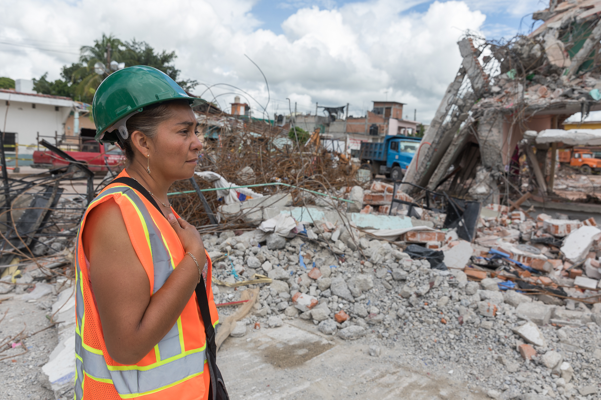 Verónica Bravo Santamaria looking at her home as it is being demolished. Six people lived in the house including her husband, her children Francisco Antonio and Mari José, and her in-laws.They are currently sleeping in their truck.PHOTO: Francisco Alcala Torreslanda