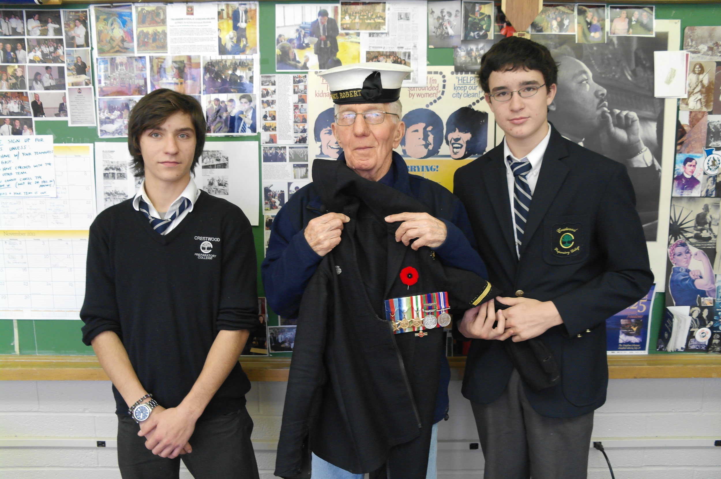Second World War Navy veteran with students Victor Lantos and Robert McKay.