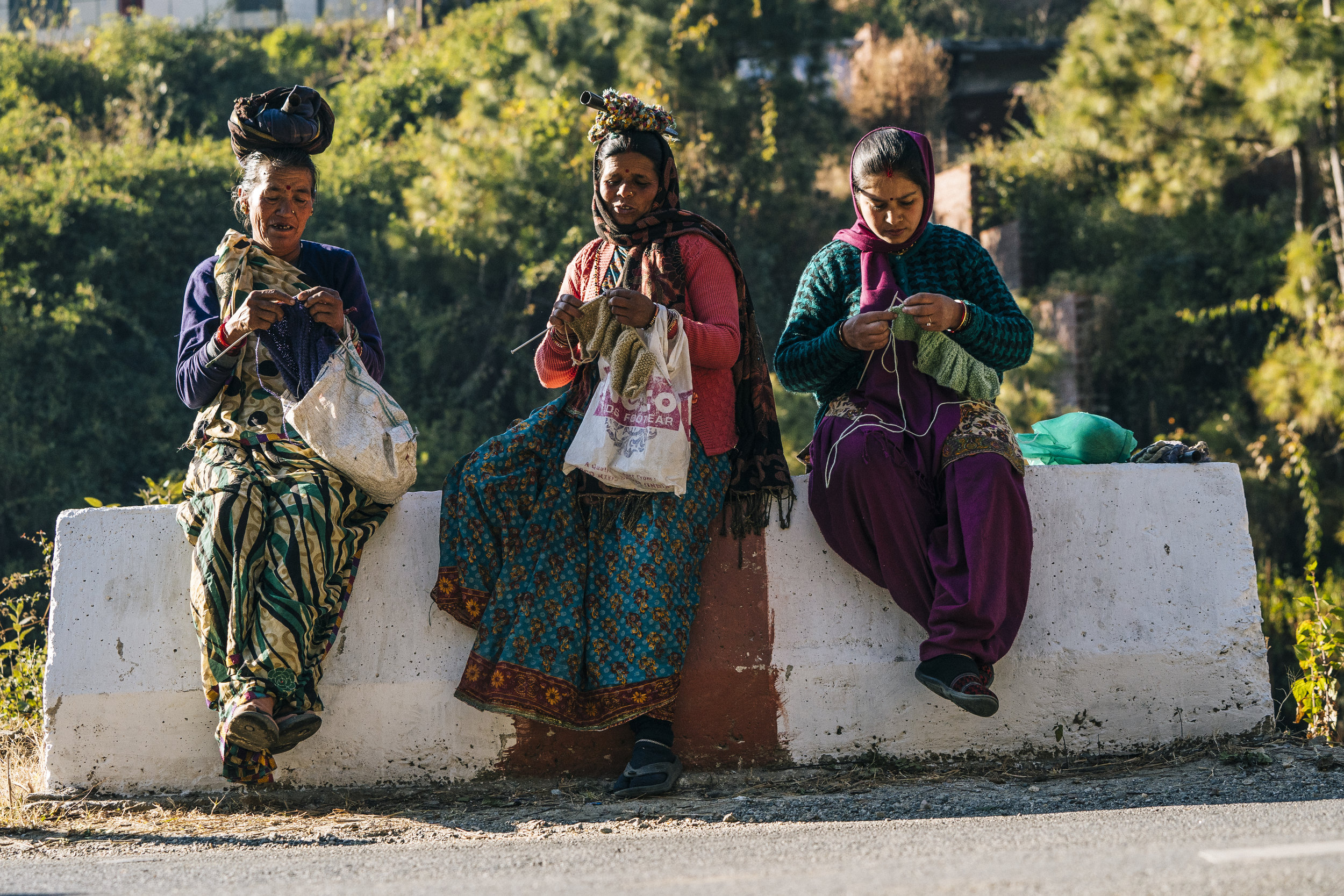 Local women working on hand-knit products.  PHOTO: Matthew Delorme