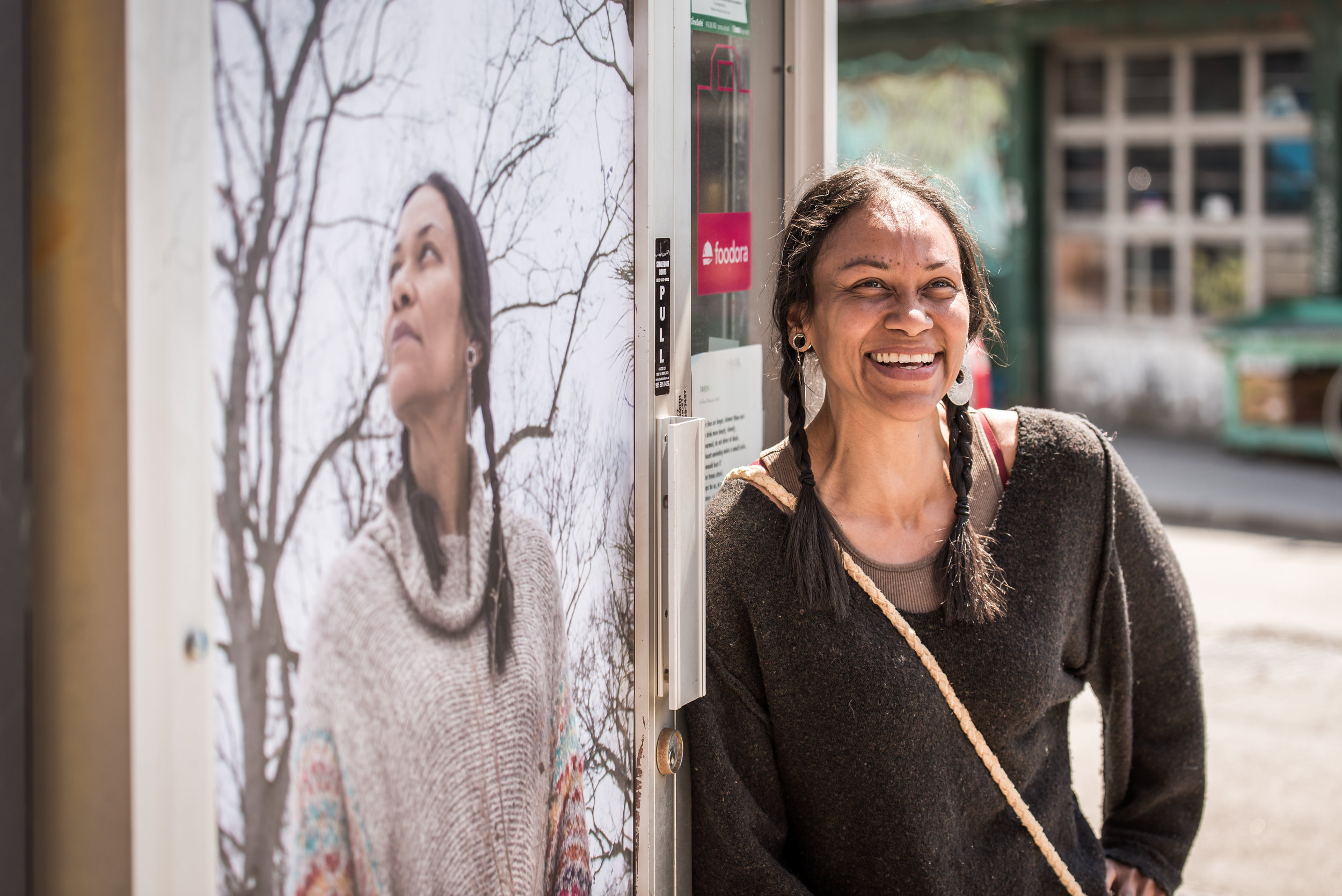 Carolynne Crawley, a child & youth worker, educator and holistic nutritionist, poses next to her portrait.   PHOTO: Ben Marans