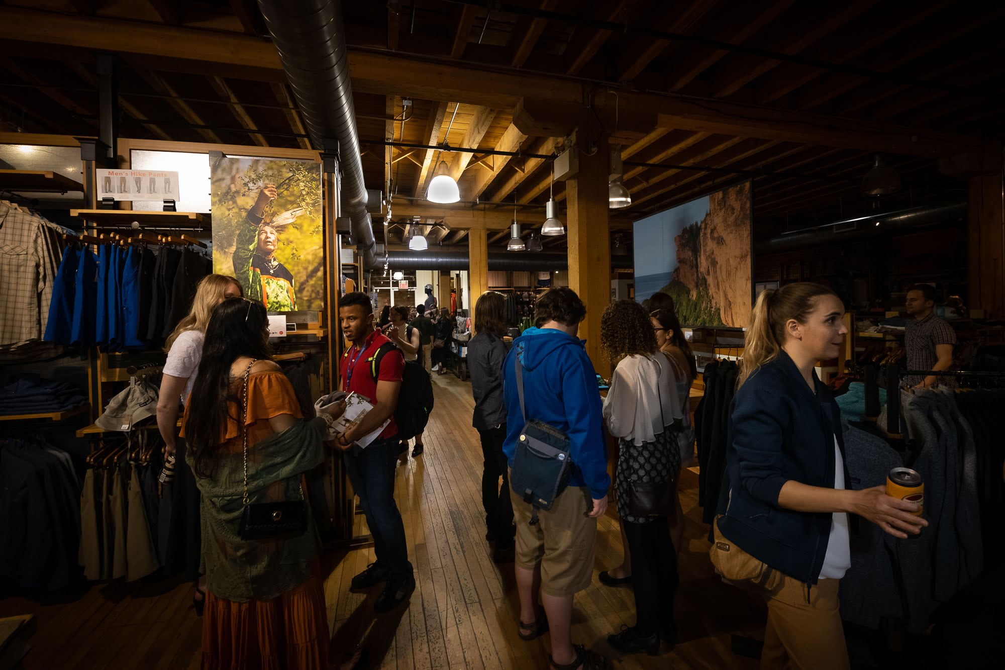 People gather to enjoy the reception for the EVC and CONTACT exhibit, on display at the Patagonia store for the month of May.   PHOTO: Dave Coulson