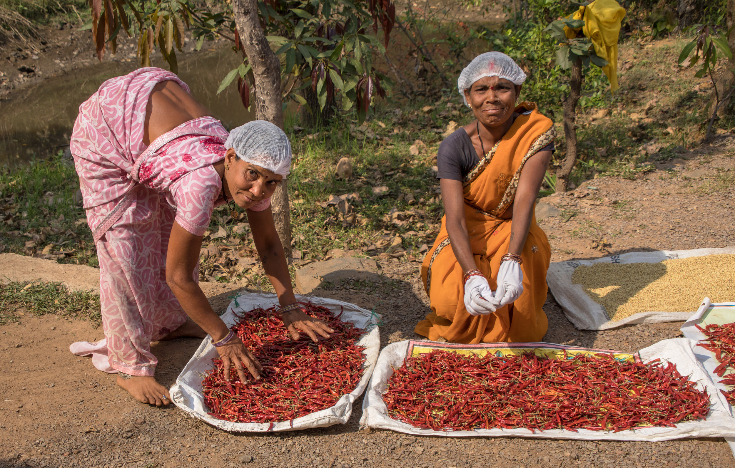 A couple local women prepare a mix of spices to be sold in nearby markets.