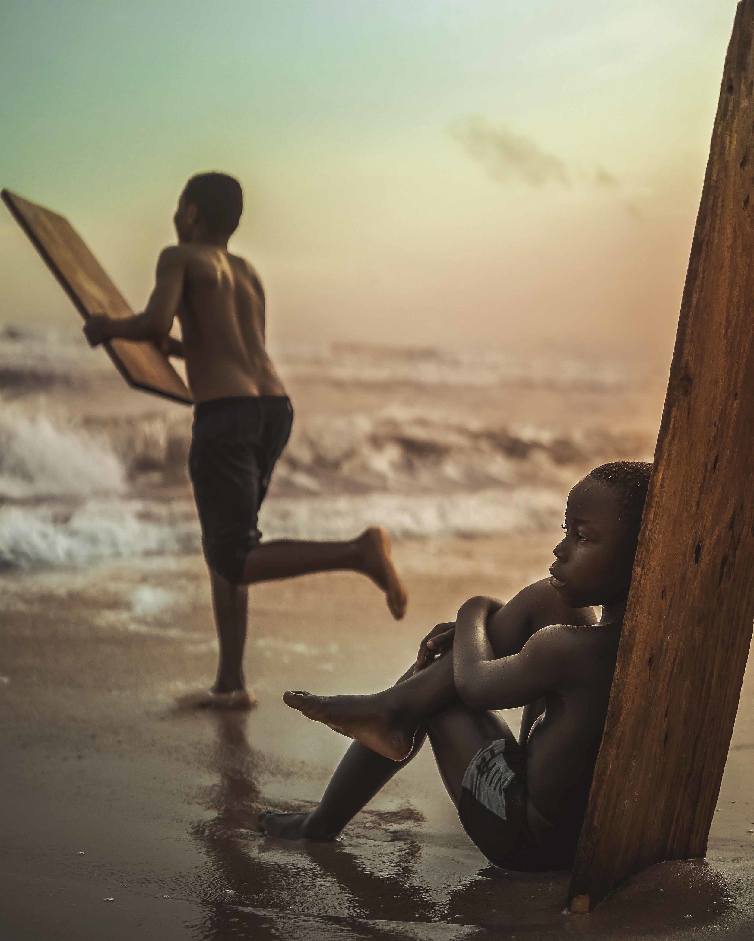 "I don't wish for something more, but I hope to find those open doors. So I'll be on my way running through the water, for i know there is something for me out in the cold. .  ""Gone Surfing"" by Michael Aboya @aboya.8"
