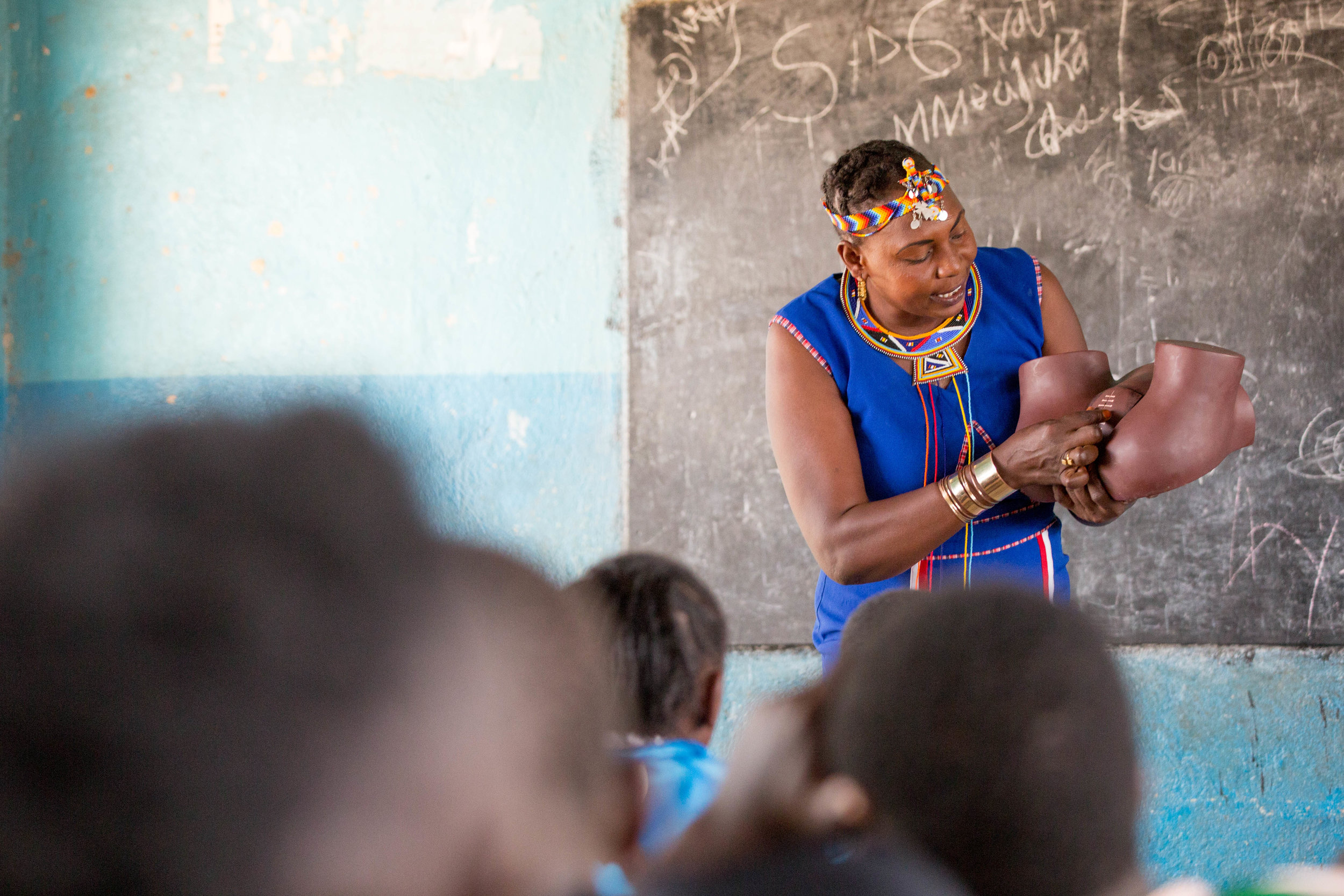 Elizabeth Lemoyog educates youth on the harmful effects of female genital mutilation.  Photo by Kelly Schovanek