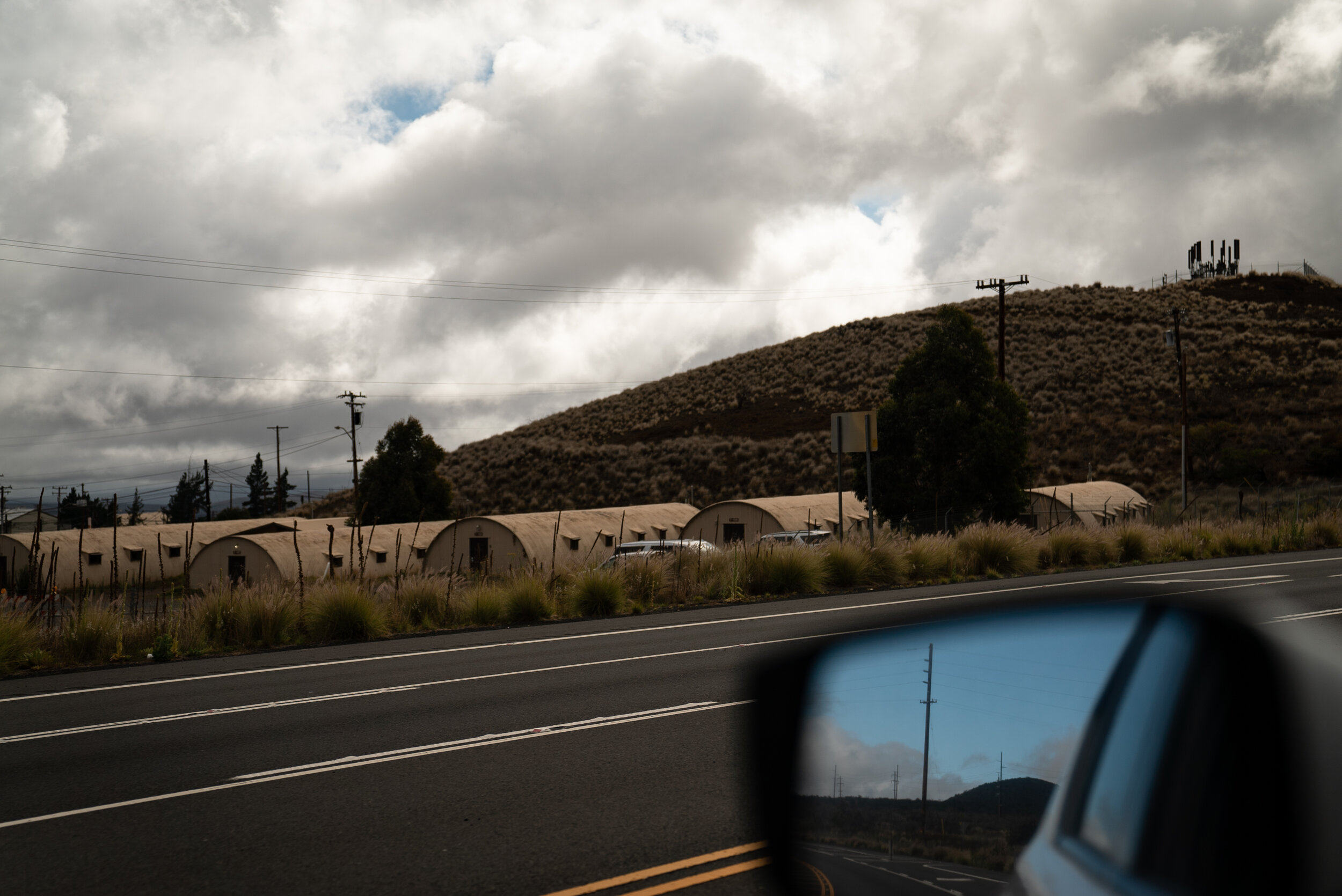 A military base just a mile away from the Mauna Kea Access Road, where bomb blasts can be heard regularly.
