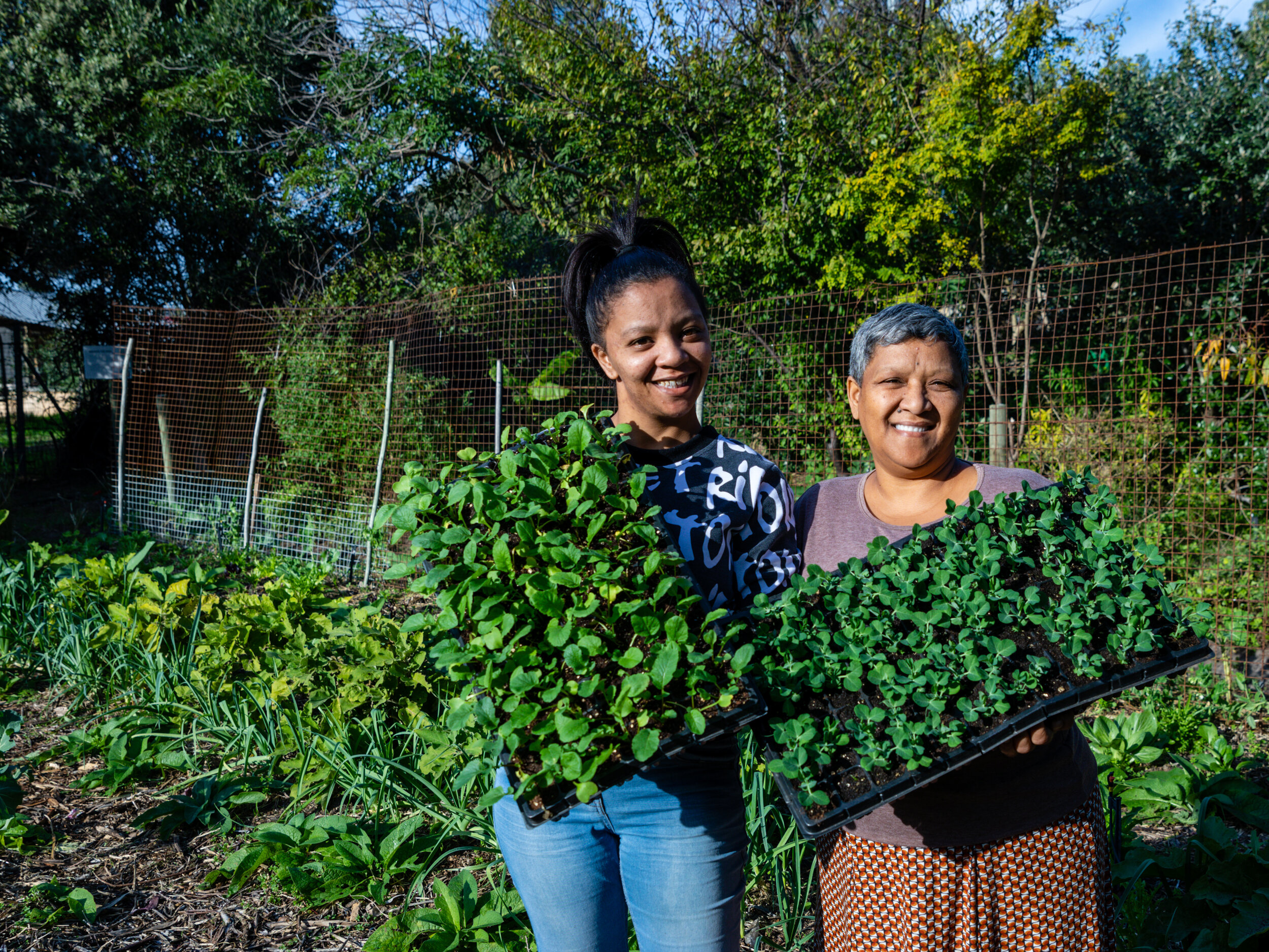 SEED staff member Gail, and her daughter Jessie, care for community gardens.  Photo by Lou Gilbert