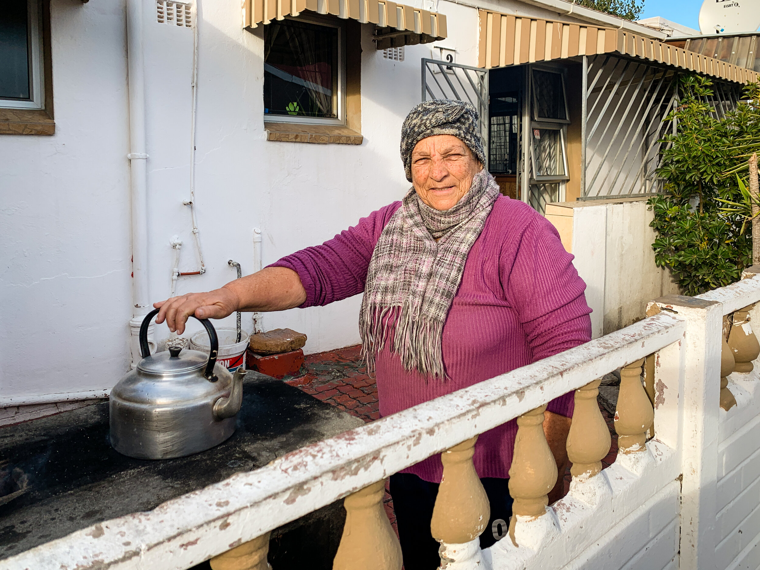 """Aunty Margaret prepares meals for her community using a new """"rocket stove"""".  Photo by Lou Gilbert"""