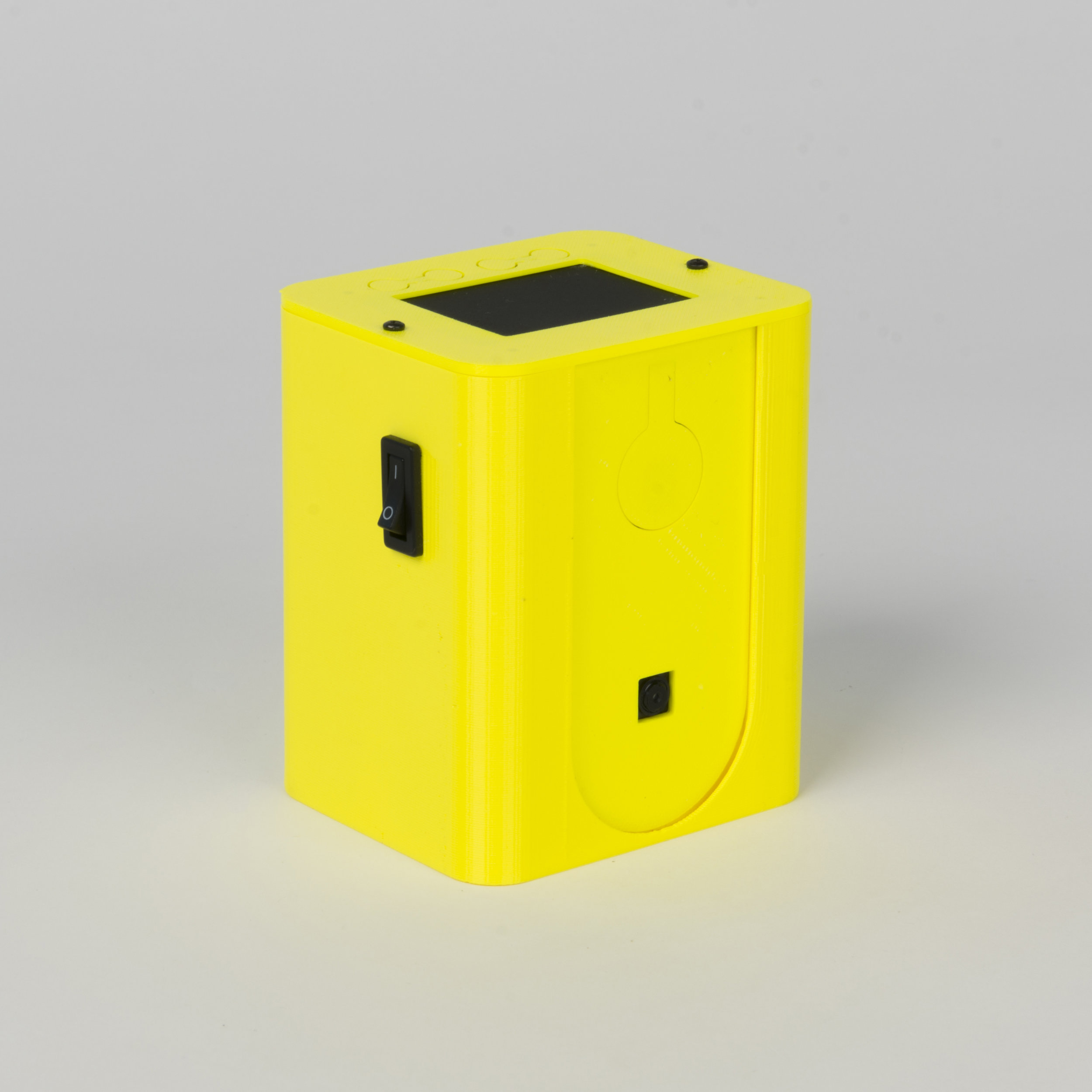 Tall Box Camera    This is a complex housing constructed from three 3D printed parts which orienate the Raspberry Pi and screen perpendicular to each other, requiring a set of jumper wires to connect the input/output pins of the adjacent boards..  more