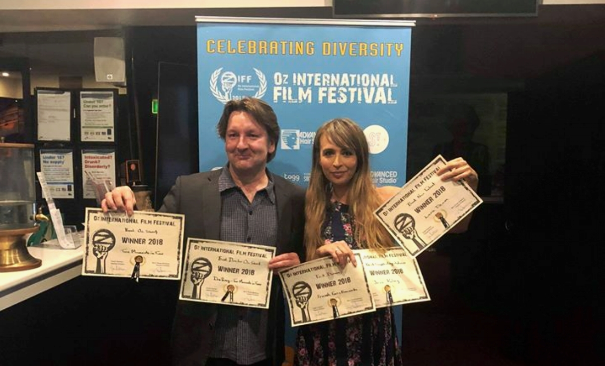 Indie filmmaker Donald Percy with his winning certificates and Lara Deam with the winning certificates for Friends, Foes & Fireworks