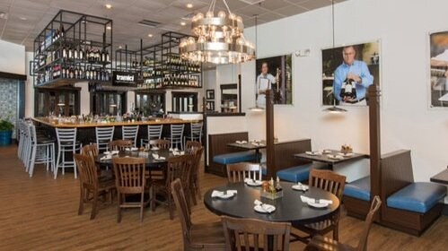TRAMICI RESTAURANT - Enjoy Italian-inspired cuisine in Tramici's energetic, warm, and inviting dining room, beneath the shaded awnings of their deck and patio, or at the open bar that overlooks the kitchen.View in Directory