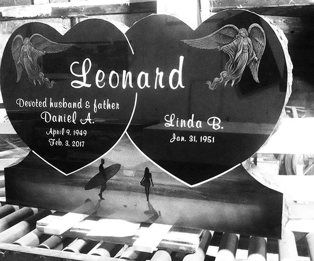 Double heart monument. Sanblast sunk lettering and lines with white litho, laser etched angels and beach scene. #blackgranite #monument # #laseretching #beachscene #angels #cochransinc