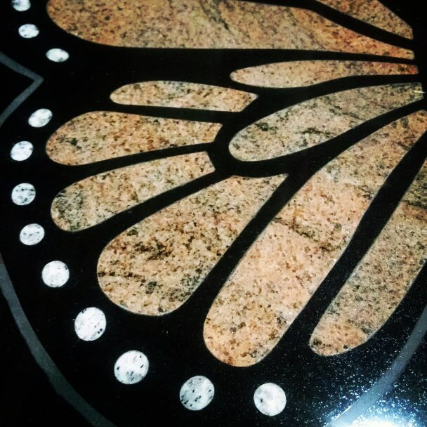 We are in #love with this bench with a #monarch butterfly inlay and cremation pedestal! #granite #bench #monument #butterfly