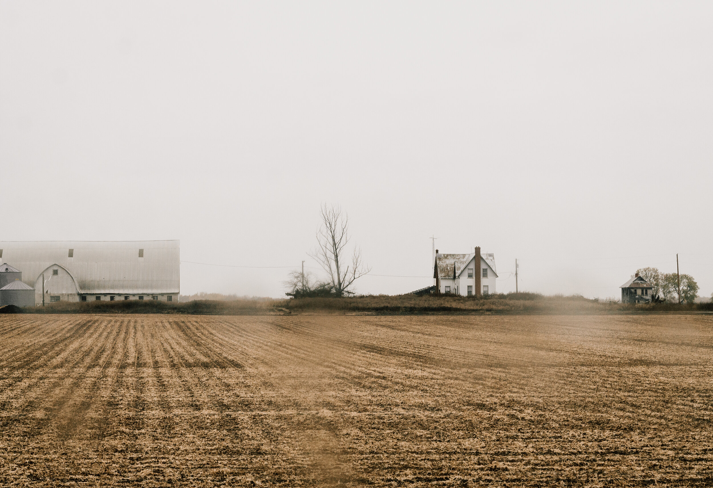 A farm in Northern Ontario, seen for a moment through a car window.