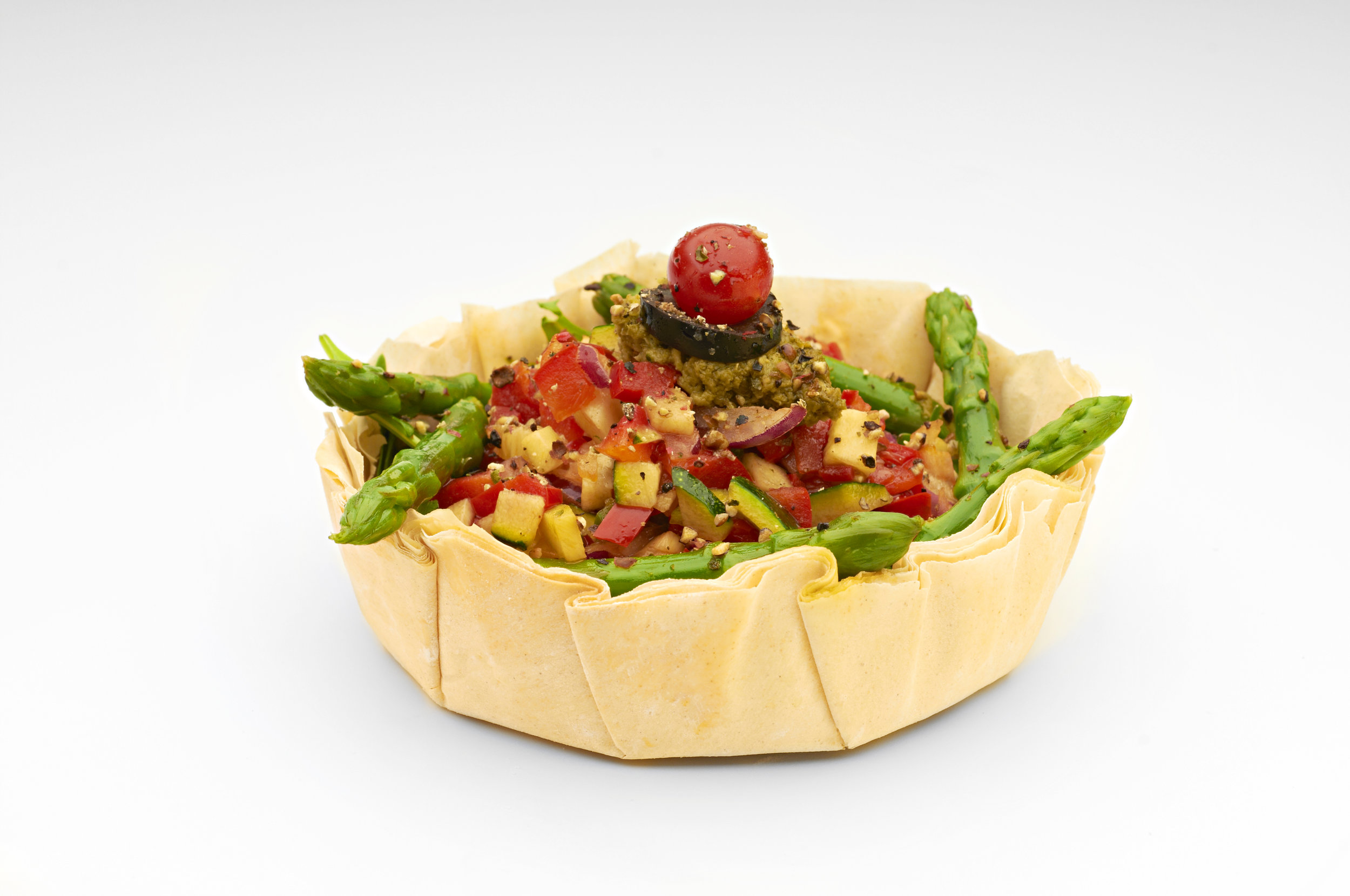 "Mediterranean roast vegetables and steamed asparagus in a  5"" Filocrown  dusted with black pepper.  Product code - FF3050"