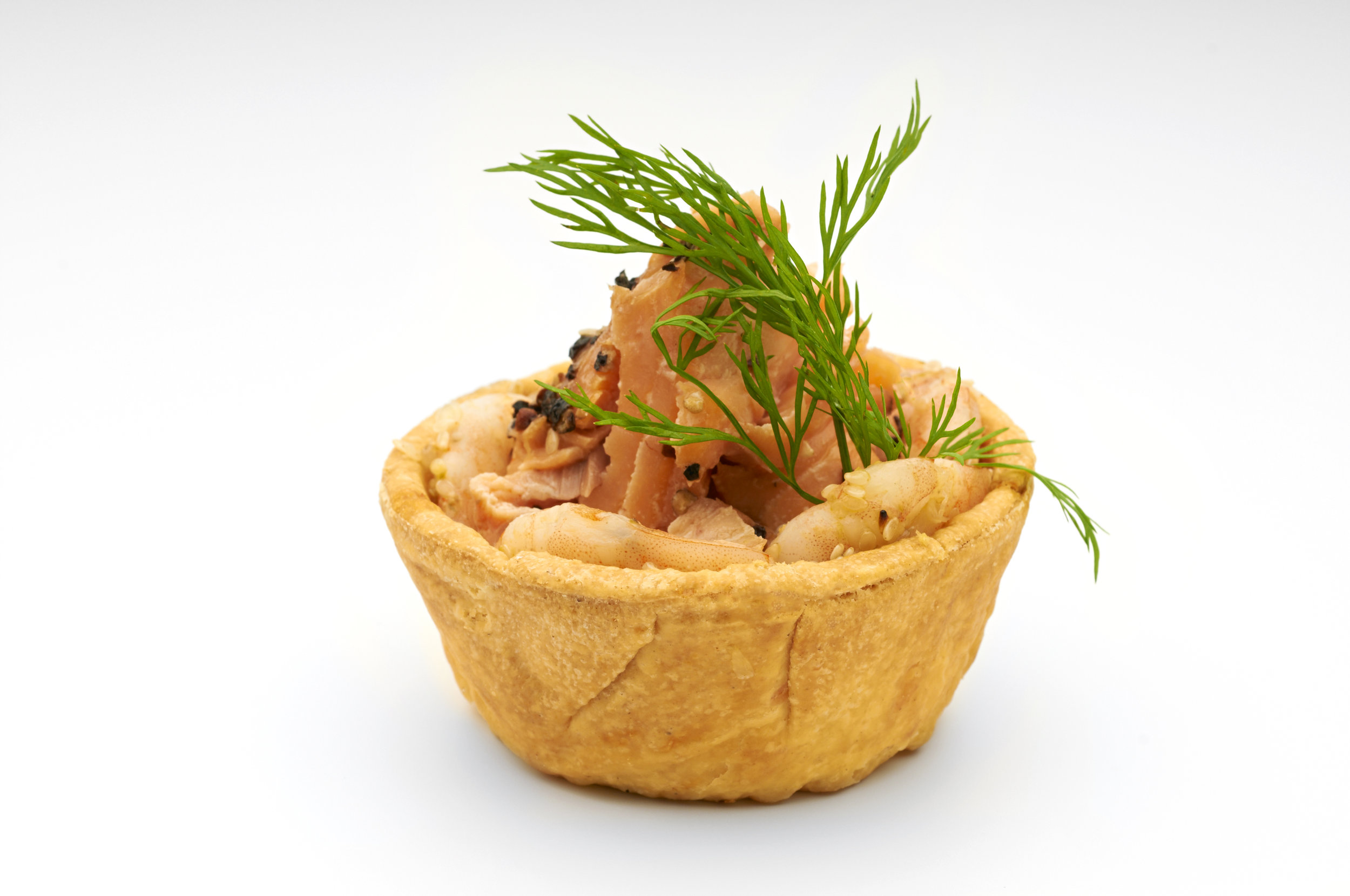 "3"" Cheese Straw Basket  holding a light lemon scented salmon mousse with flaked wild peppered salmon and dill oil.  Product code - FF2030"