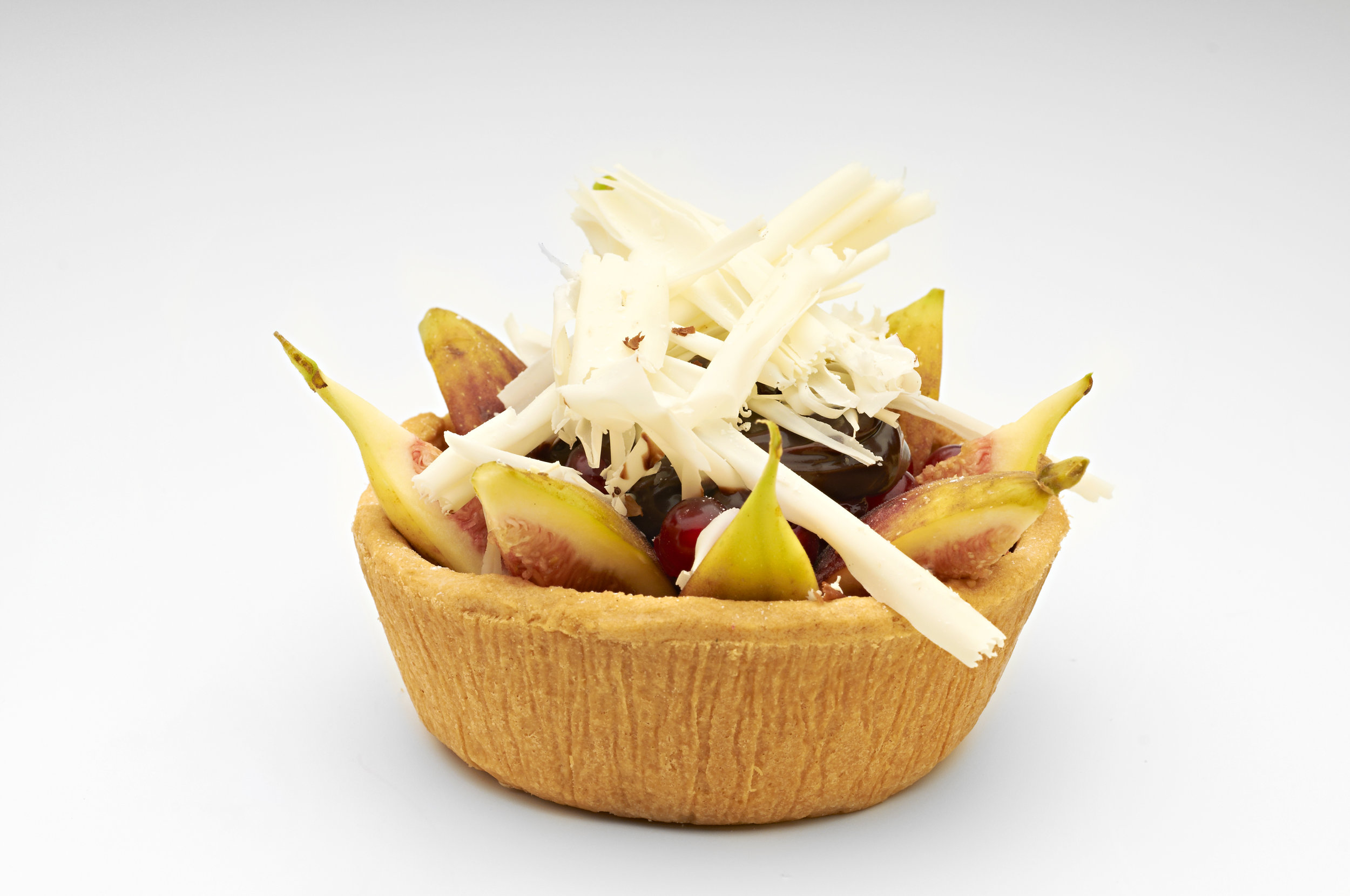 """Black cherries and honey glazed fig in almond vanilla cream on  4"""" Short Sweet Pastry Basket.   Product code - FF5340T"""