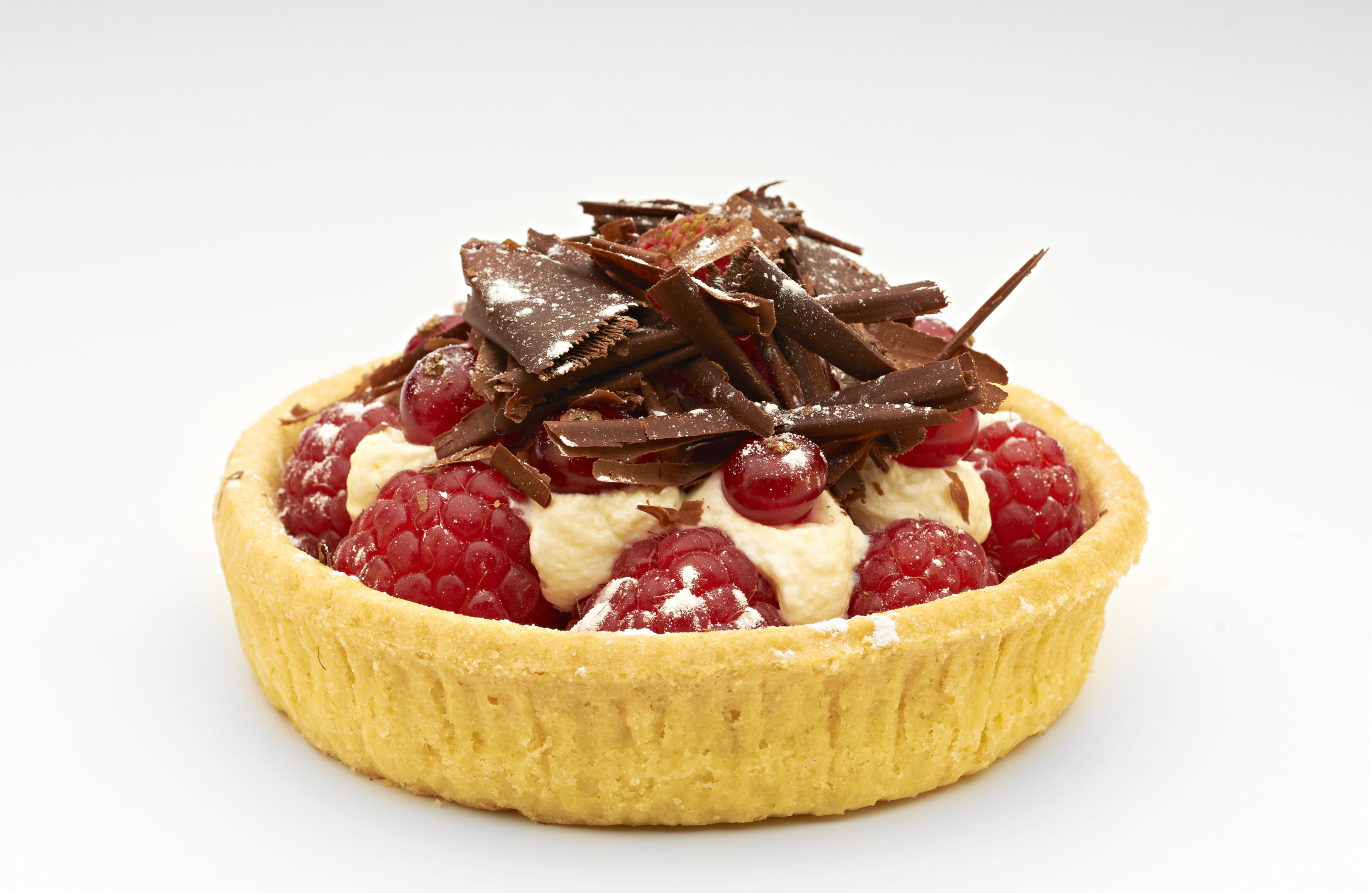 """Fresh raspberries on a white chocolate crème patisserie topped with dark chocolate shaving presented on  4"""" Short Crust Vanilla Case.   Product code - FF5340V"""