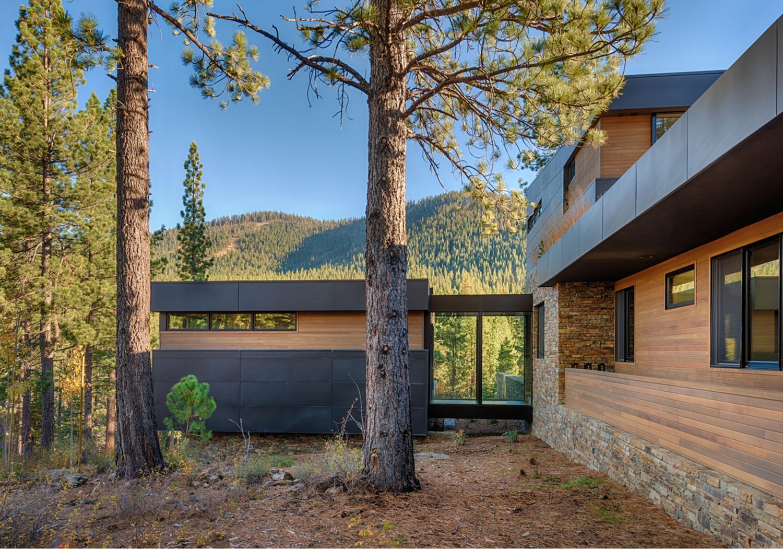 Lot 381_Exterior_Side View_Metal Siding_Master Suite Bridge.jpg