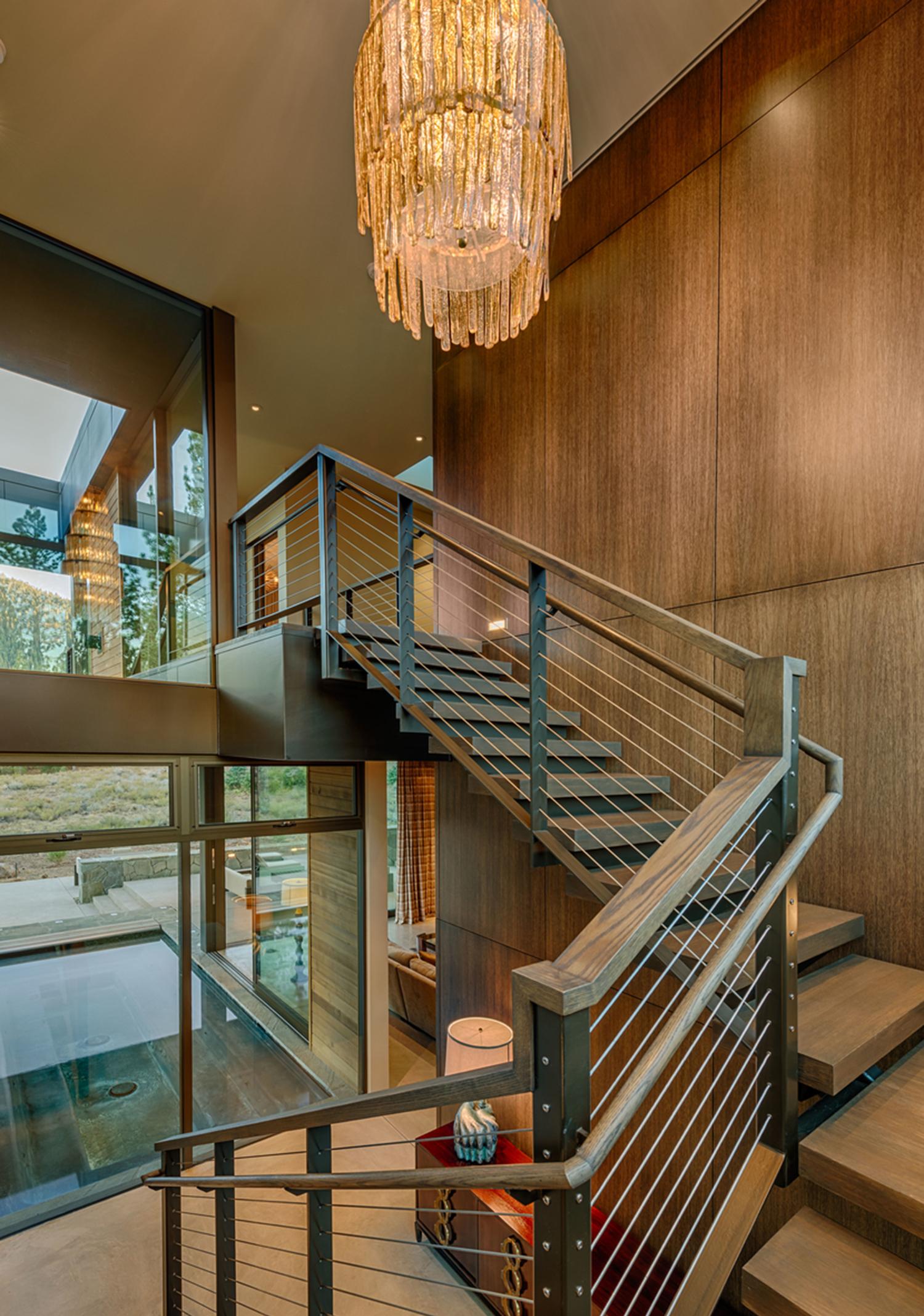 Lot 403_Staircase_Metal Railing_Wood Panel Walls_Chandelier.jpg