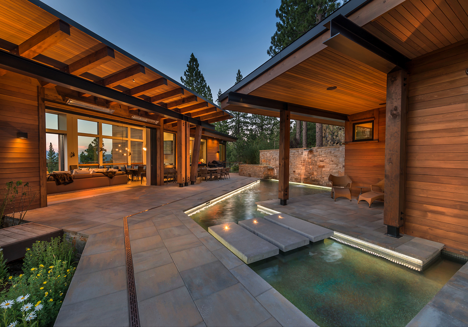 Lot 595_Exterior_Water Features_Concrete Pavers_Weiland Doors_Horizontal wood siding.jpg