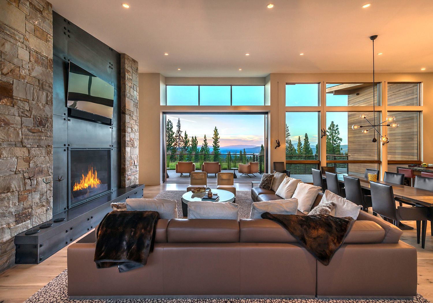 Lot 595_Great Room_Fireplace_Int Metal Cladding_Weiland Door_Deck_View.jpg