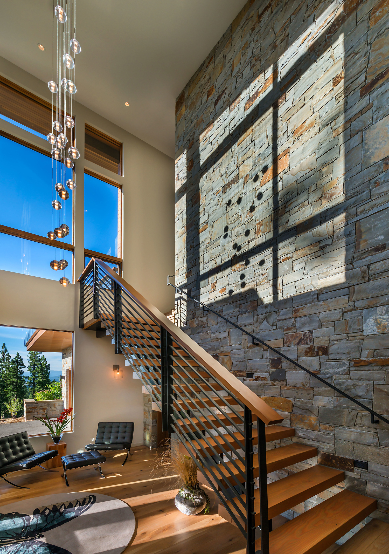 Lot 595_Stairwell_Int Masonry_Windows_Chandelier.jpg
