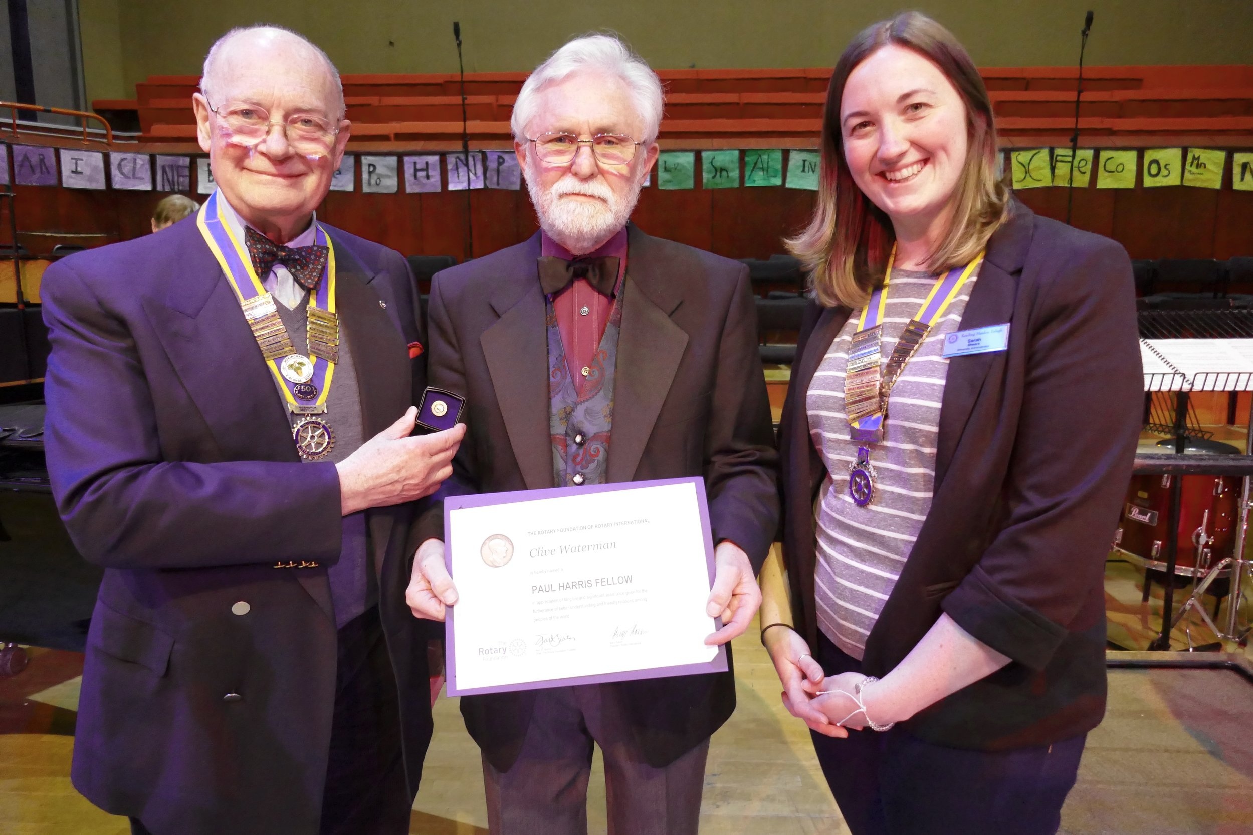 Photo:  Rotary presidents,   Keith Greenwood (left) and Sarah Shears (right) present the award to Clive Waterman