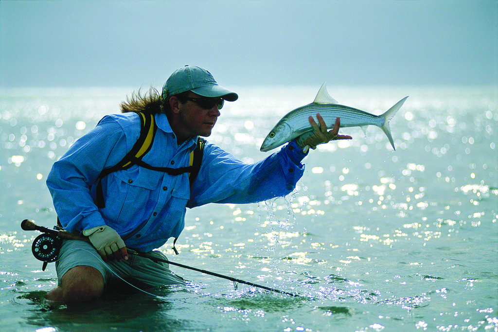 Guide Arno Mathee with bonefish on St. Joseph Atoll in the Seychelles
