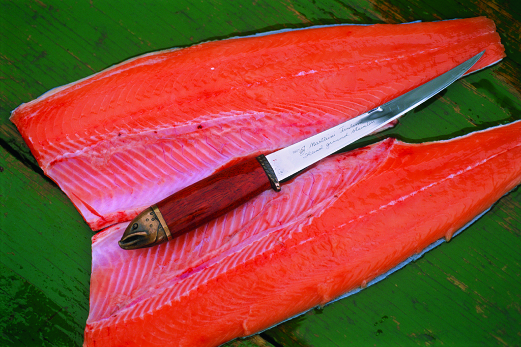 Atlantic salmon fillets and Swedish knife in Russia