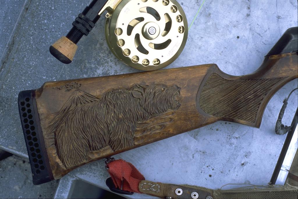 Bear gun and fly rod Kamchatka, Russia