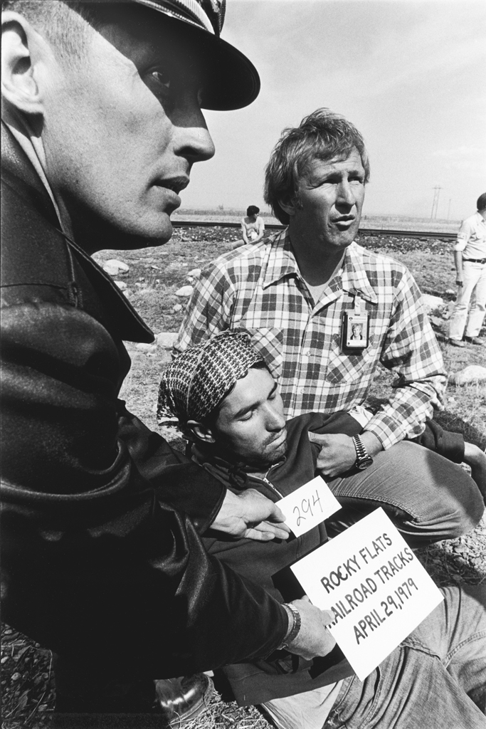 One of the last to be arrested that day was original Truth Force member, Patrick Malone. Seemingly blissful in his sixth arrest, Malone was to encounter serious legal problems for his continued involvement in the action against Rocky Flats.