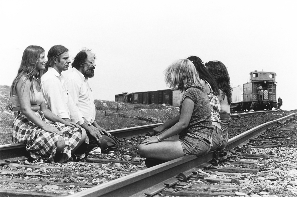 June 16, 1978: Poets Allen Ginsberg and Peter Orlovsky, along with four women, block a train leaving Rocky Flats. Already that morning seven people had been arrested, blocking the same train as it entered the plant.