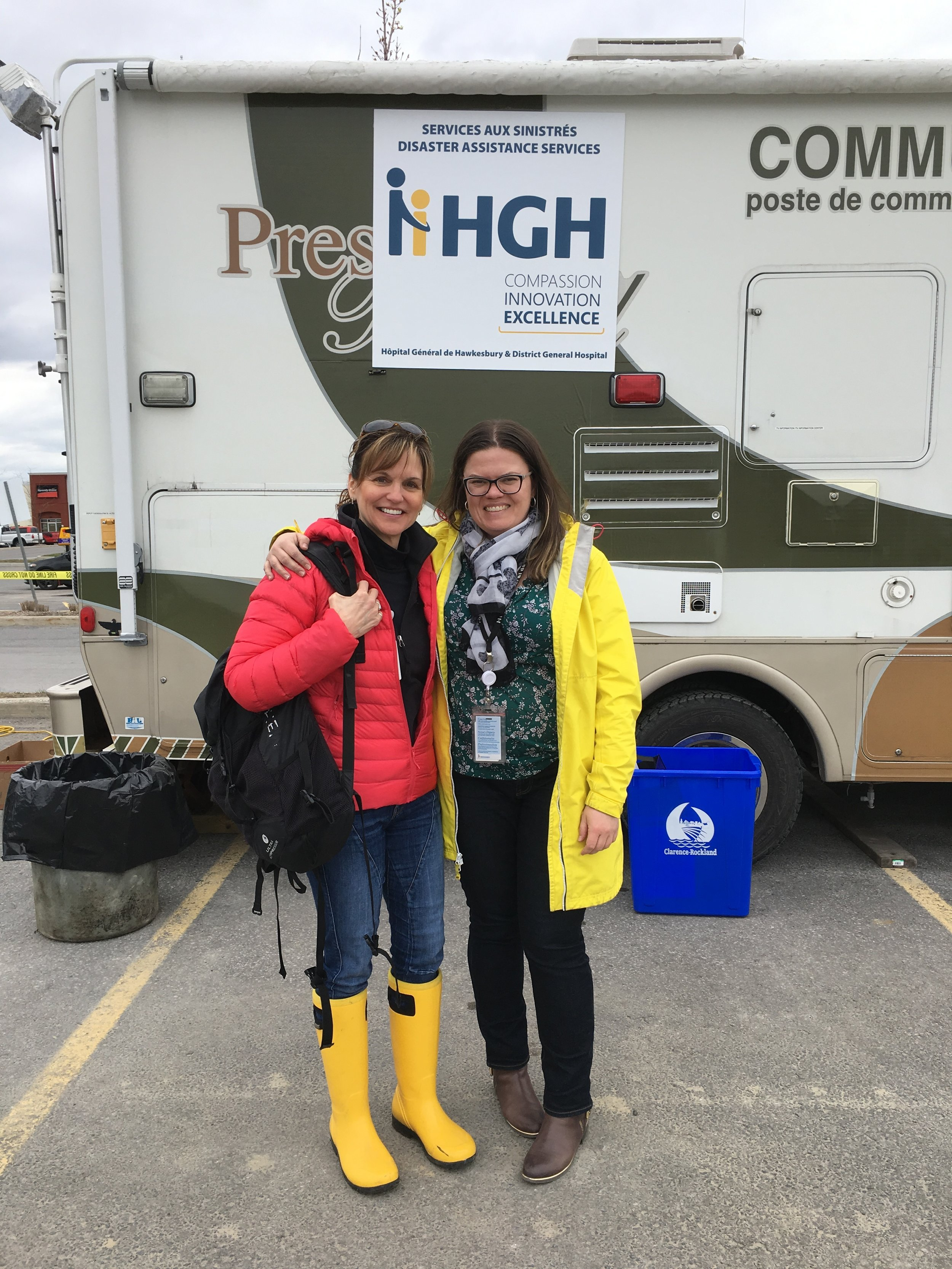 Dr. Filion (in red) with Tina from the CRISIS SERVICE OF THE HAWKESBURY AND DISTRICT GENERAL HOSPITAL.  Dr. Filion is going door-to-door, providing prevention and intervention mental health services to the victims.