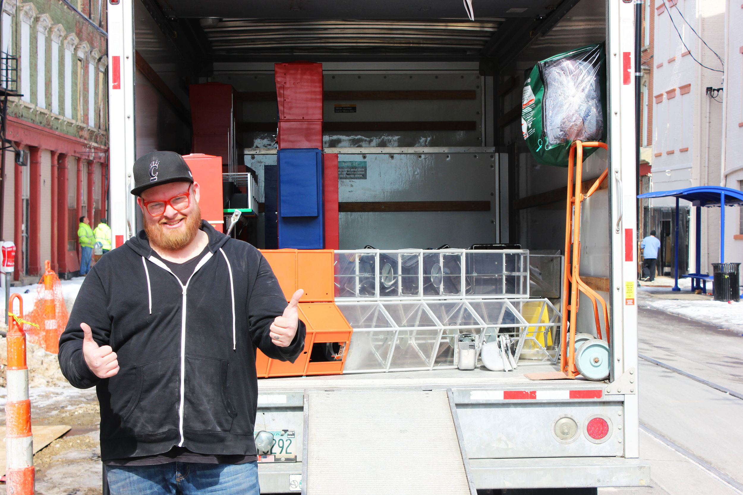 Jason Snell unloads his U-Haul. The first of the vending machines have arrived at the Globe.