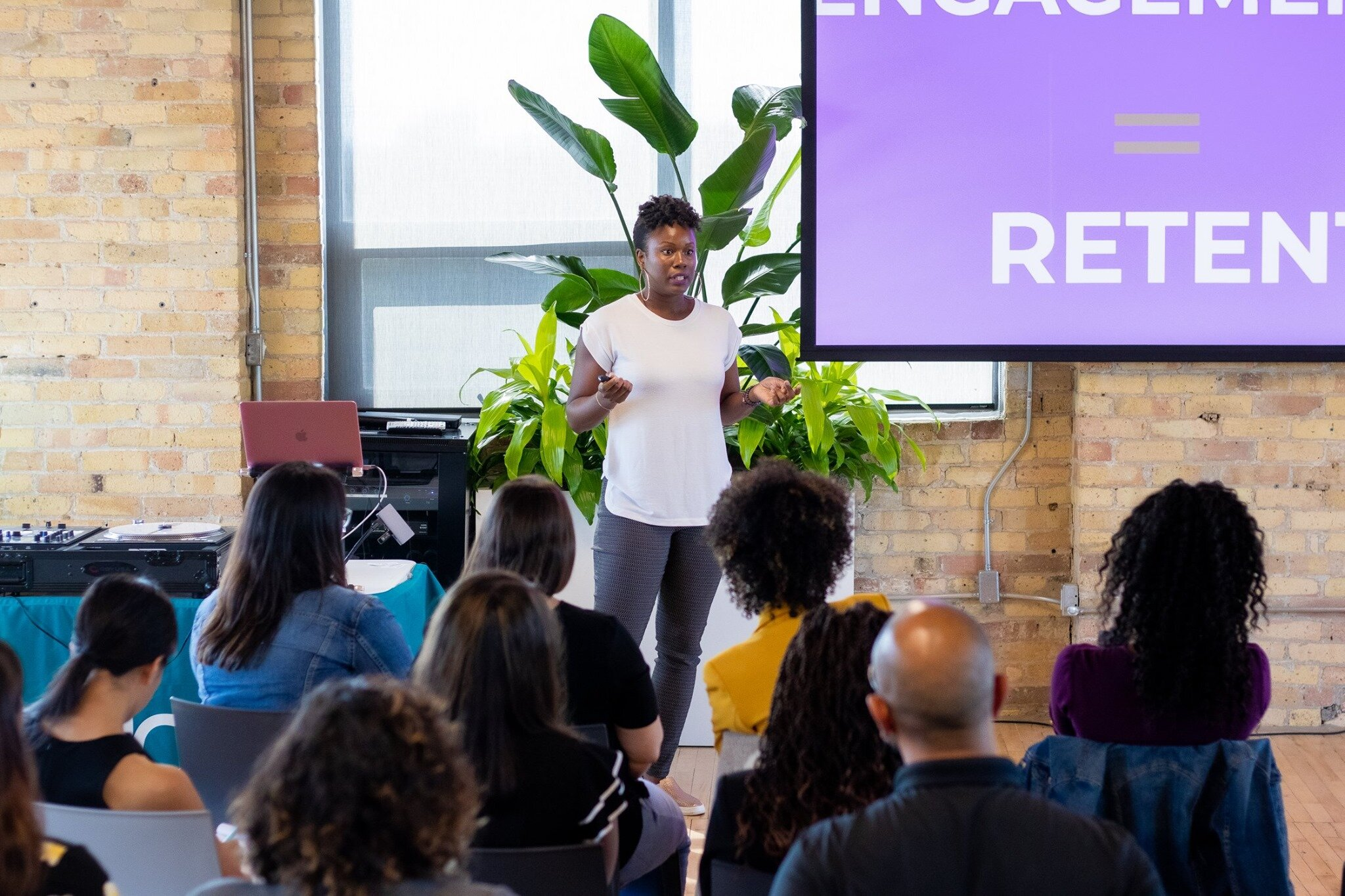 That's me in the picture above giving my 5 min Ted talk on how Employee Engagement = Content Marketing at Woman and Color. Then I made it into an article because I am a writer, first and furthermore, SEO but at some point, this will be a reference guide for companies who have learned to market smarter —not harder. Keep reading…