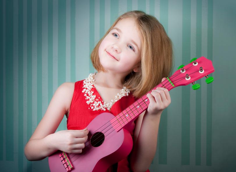 girl-plays-ukulele.jpg