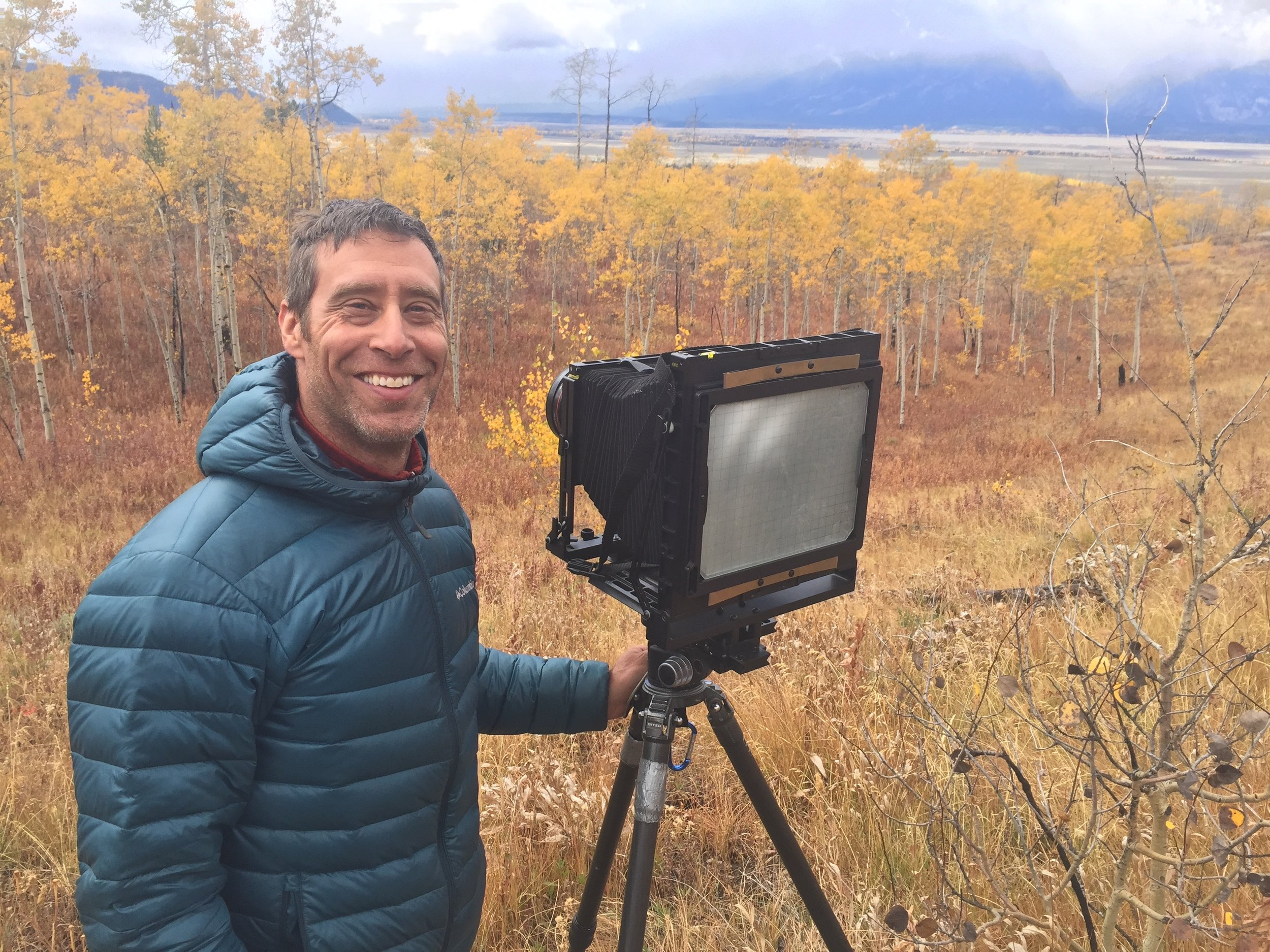A happy photographer, Jon Paul, with his 8x10 film camera in Grand Teton National Park.