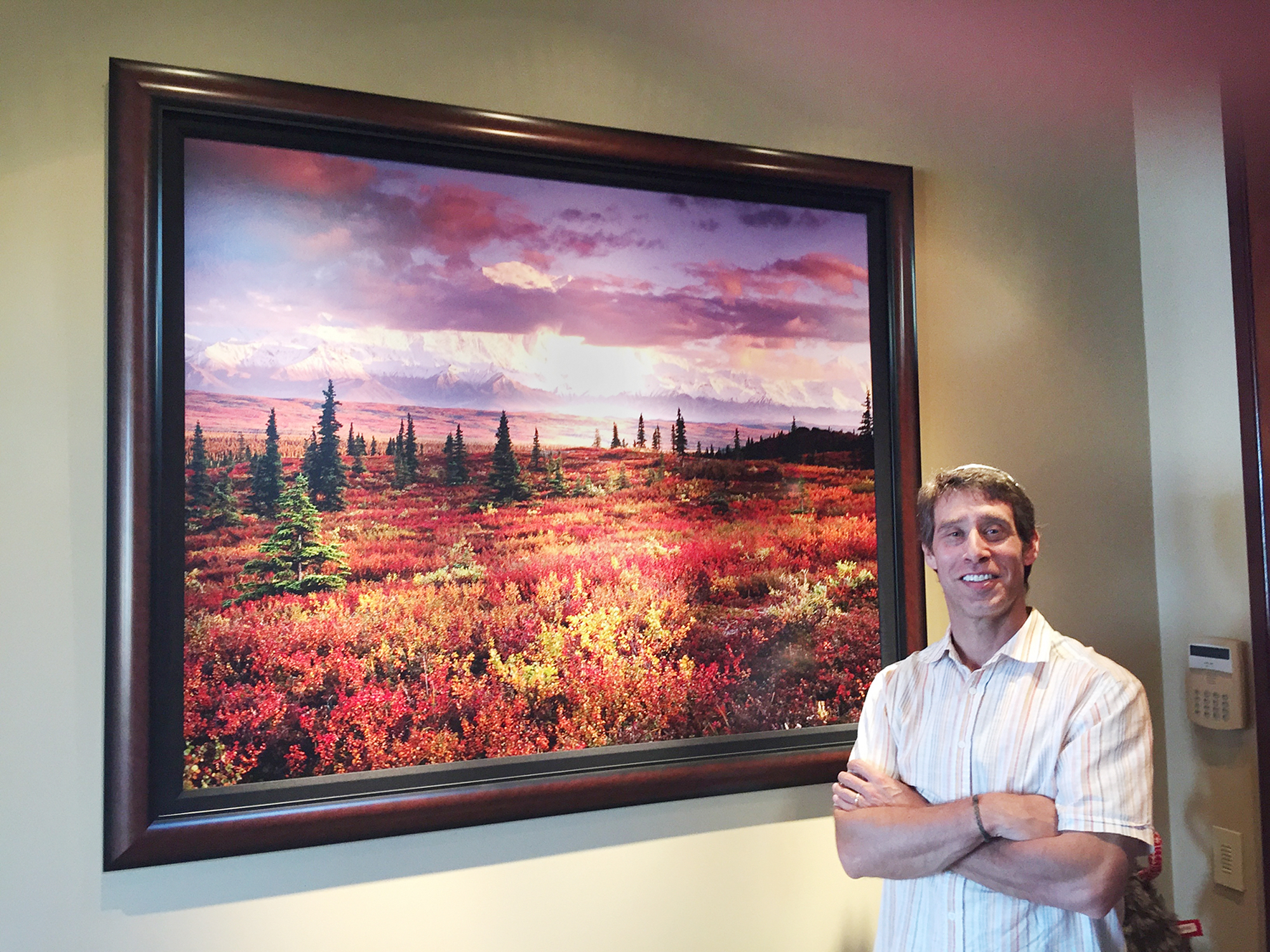 Jon Paul with a 40x50 inch (chromogenic) print on photographic paper in a collectors lakefront home.