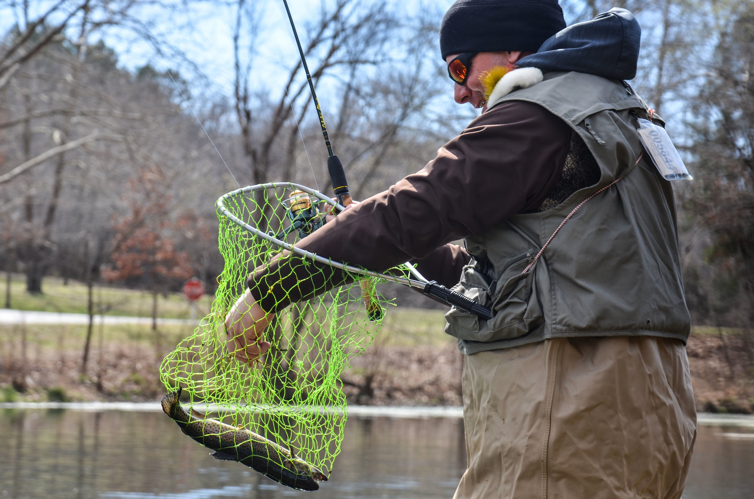 Fisherman Mike Moulin catches a trout at Bennett Spring State Park in Lebanon, Missouri, on Sunday, March 12, 2017. He was one of the thousands of fishermen who visited Bennett Spring State Park during trout season.