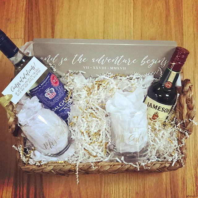 Love the chance to work with others to make an idea come to life! This is a gift a friend of mine put together for her good friends  engagement. His & her glassware paired with their favorite beverages along with a small sign made such a cute basket!