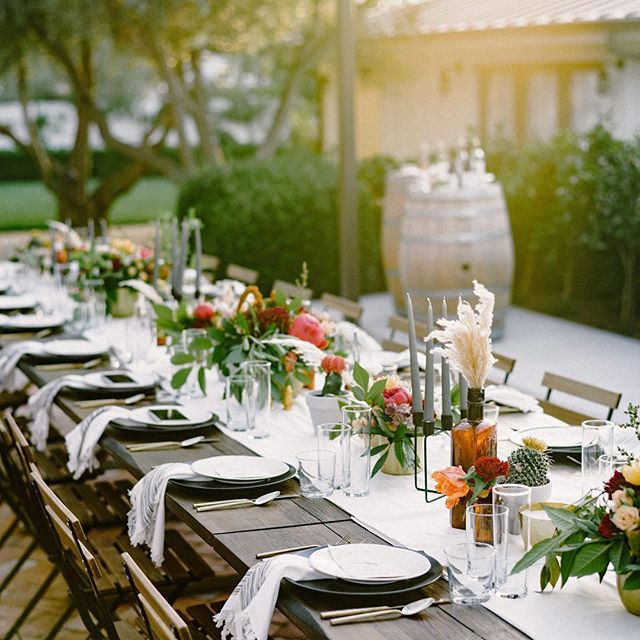 Simple can look so elegant and inviting. One of my favorites!!! Loved working with all these incredible vendors of @nearest.dearest.slo .... we are a team of wedding professionals providing a one stop shop for intimate weddings in SLO county. You come to us with the dream and we do all the work to execute your dreams to life. . . Serving intimate weddings of 50 guests or less. .. .. .. . Collaboration: @nearest.dearest.slo Photographer: @loveridgephotography Videography: @steelheadcinema Planner & Designer: @samanthajosetteevents Florist: @aurelia.flora Hair & MU: @rhyantownsend Cosmetics: @houseoftherozetree Furniture Rentals: @avenuetwelverentals Tabletop Rentals: @gycrentals_ Linens: @blushfinelinens Caterer: @floraandfaunafinefood Bar: @copperandcrystal Bakery: @pardonmyfrenchslo Venue & Wine: @biddleranchvineyard Live Music: @comealiveentertainment Dj: @djsparrowentertainment Stationary: @feteteandquill Dress: @shopthemeadow Accessories & Jewelry: @amour_jewelry_accessories .. .. .. .. #intimatewedding #sloweddings #sloweddingplanner #nearestanddearest #smallwedding #weddingstyle #tablescape #farmtotabledinner #vineyardwedding #modernwedding #californiaweddings #weddingdesign #simpleweddingdesign