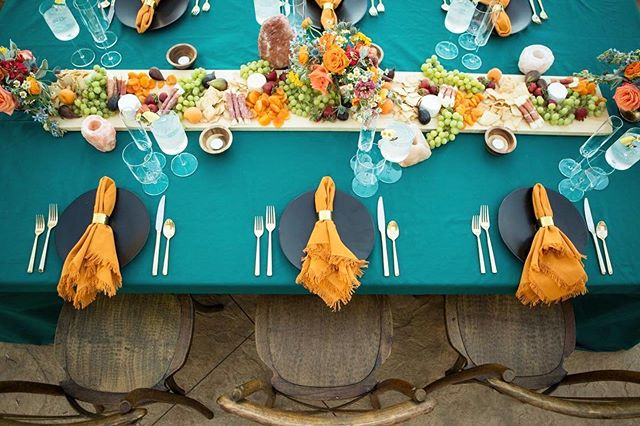 Teal linens accented with orange fringe napkins.. umm, YES. 😍 So many good reasons to drool over this one! 🤤🧡 . . We love designing things out of the box. . . Are you a bold color person or would you rather stick to the neutral colors and pastels? . Photographer @samantha.josette || Planning and design @samanthajosetteevents and @blushfinelinens || Rentals @allaboutevents and @avenuetwelverentals || Linens @blushfinelinens || Flowers @flowersbykim || Bar @copperandcrystal || Venue @ravawines || Stationary @feteandquill || . . #tablescapes #weddingstyle #weddingdesigner #outoftheboxdesigns #tuscanweddingstyle #vineyardweddingstyle #modernweddingstyle #sanluisobispoweddingplanner