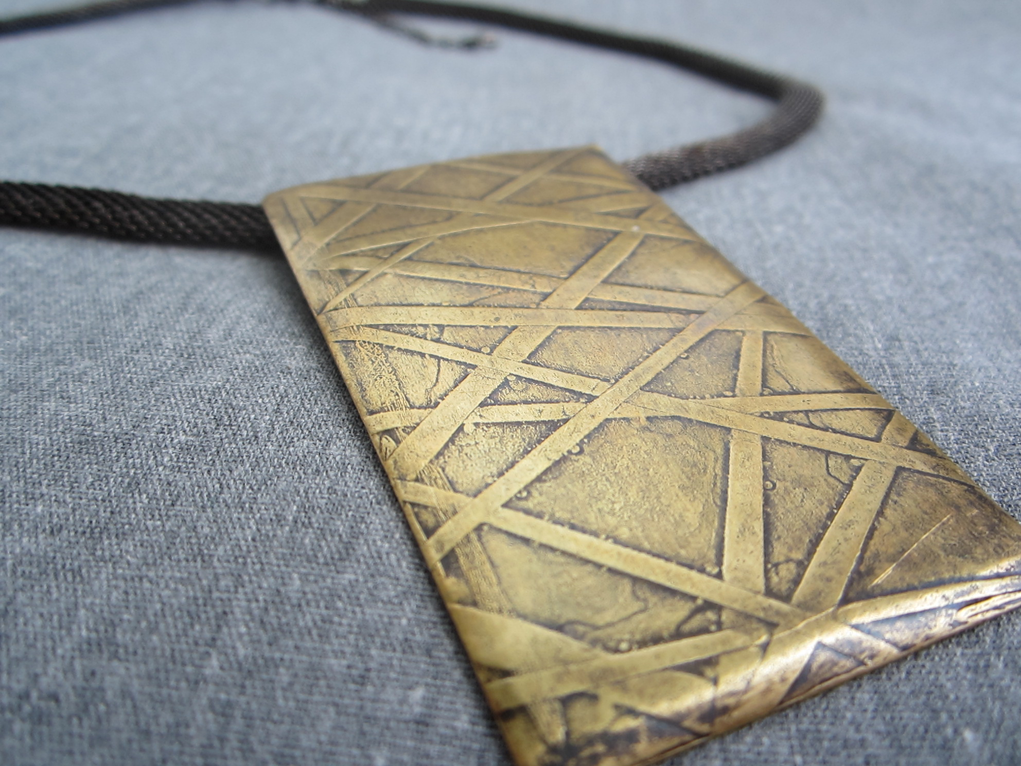 etched brass pendant