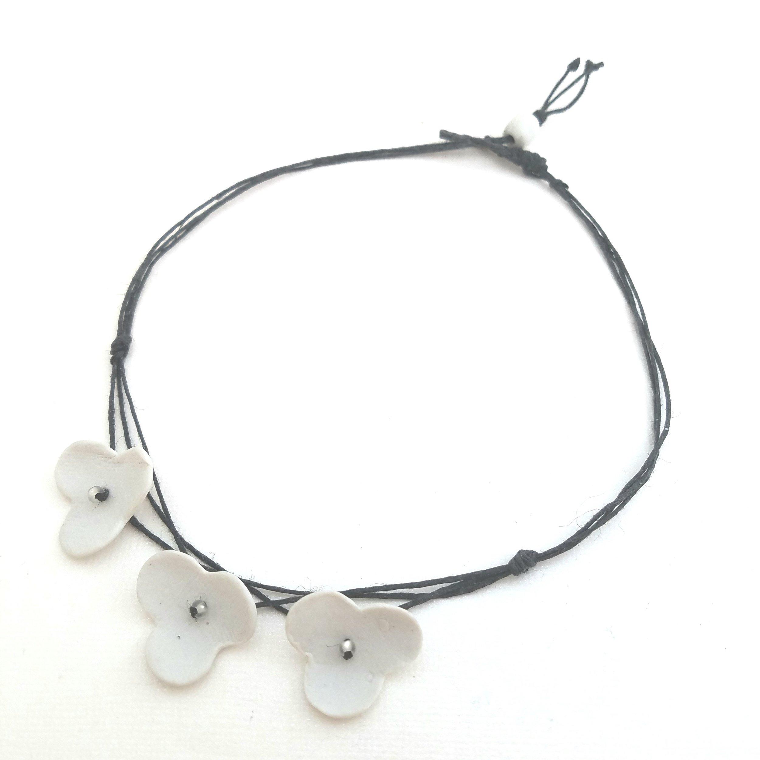 3 white porcelain flowers necklace.jpg