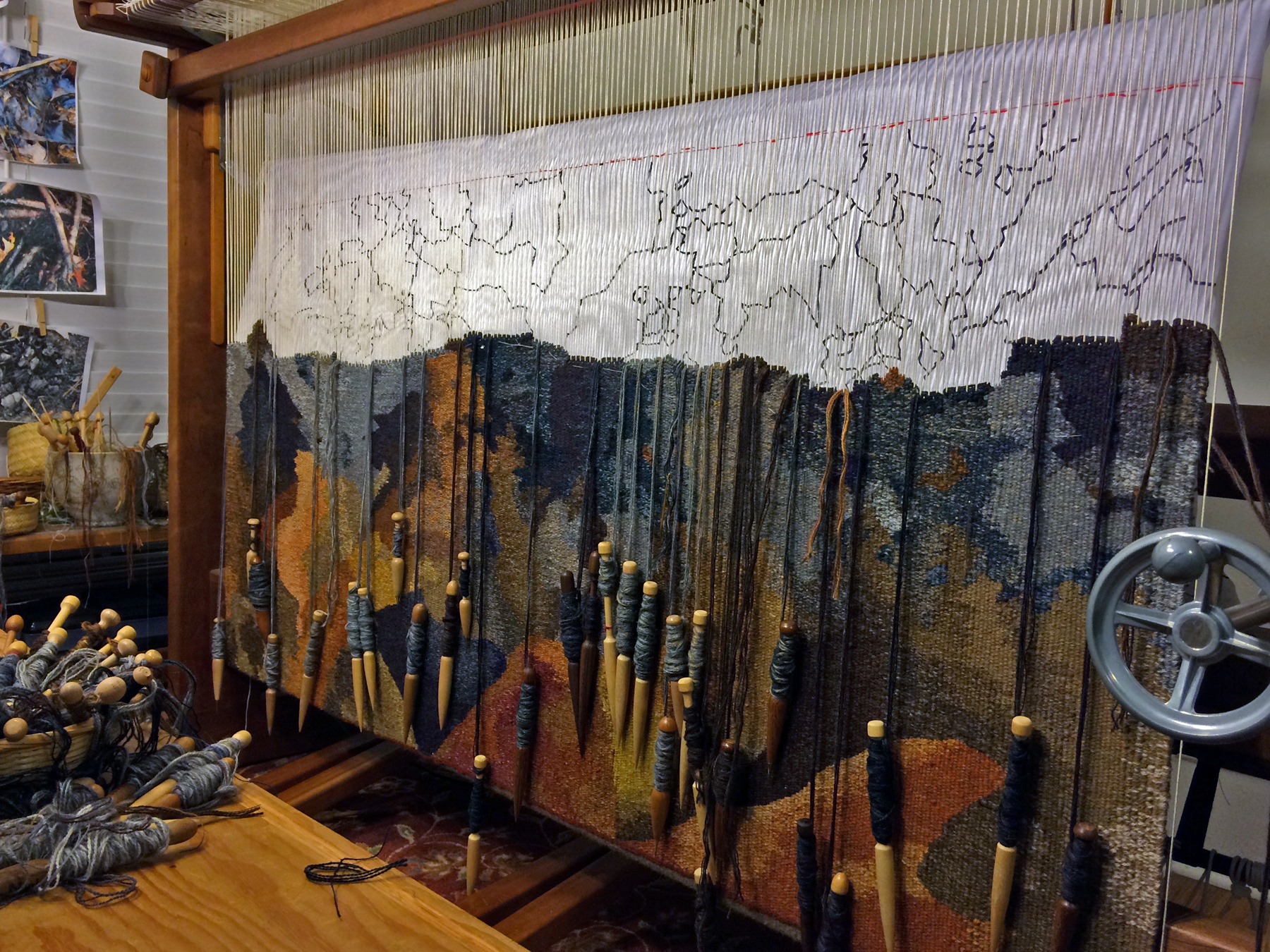 This tapestry is about the wildfires that swept through areas of the Southeast in the United States in late 2016.  Thousands of acres of wooded land were burned and at least fourteen people lost their lives.  Many more lost their homes and businesses in some of the most devastating of the fires in the Great Smoky Mountains of Tennessee.